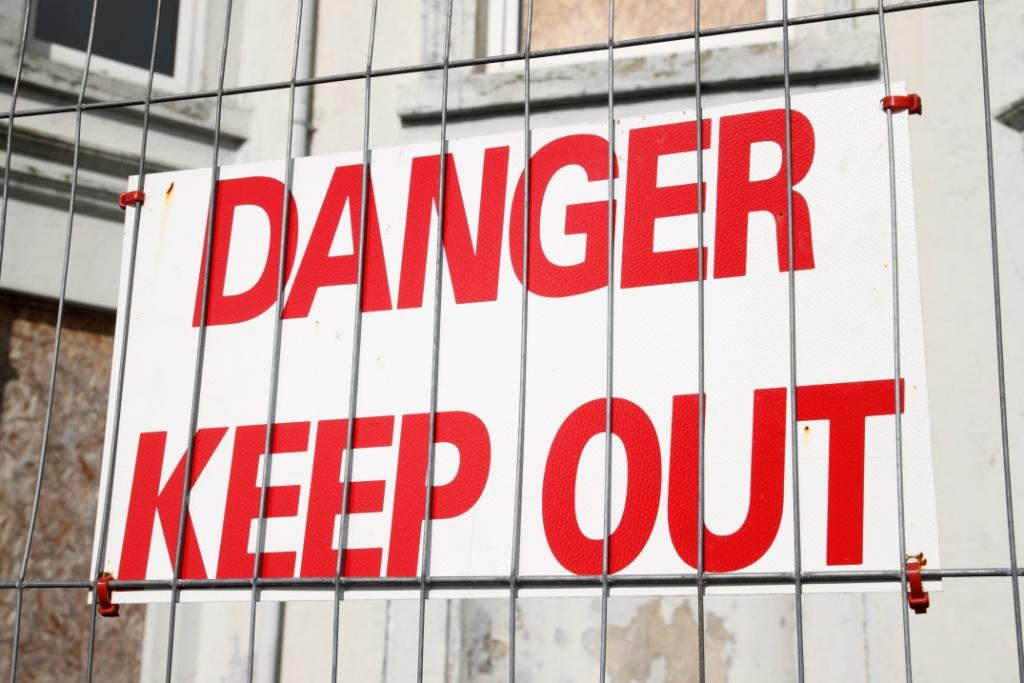 Danger keep out sign on a wire security fence.